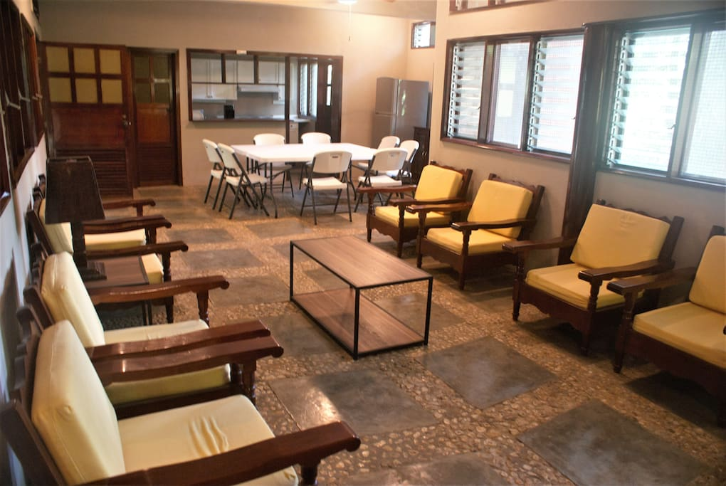 The spacious Family Room integrated with dining table and kitchenette. Half Bathroom available in this section.