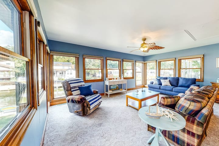 Family-friendly, waterfront home w/ two living spaces, a yard, firepit, & dock