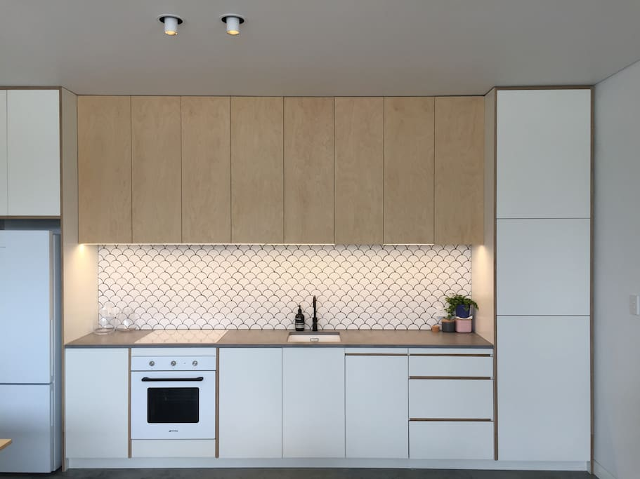 Fully equipped kitchen with SMEG appliances and plenty of storage for longer stays