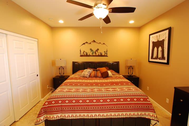 Bedroom # 1.  King bed.   Downstairs by front door.