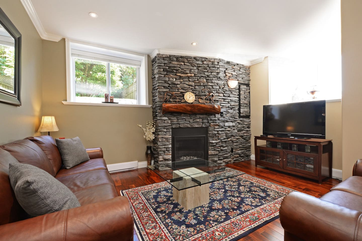 Front Living area with floor to ceiling rock fireplace.