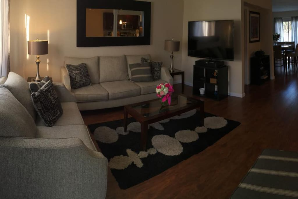 """Living room with 60"""" TV"""