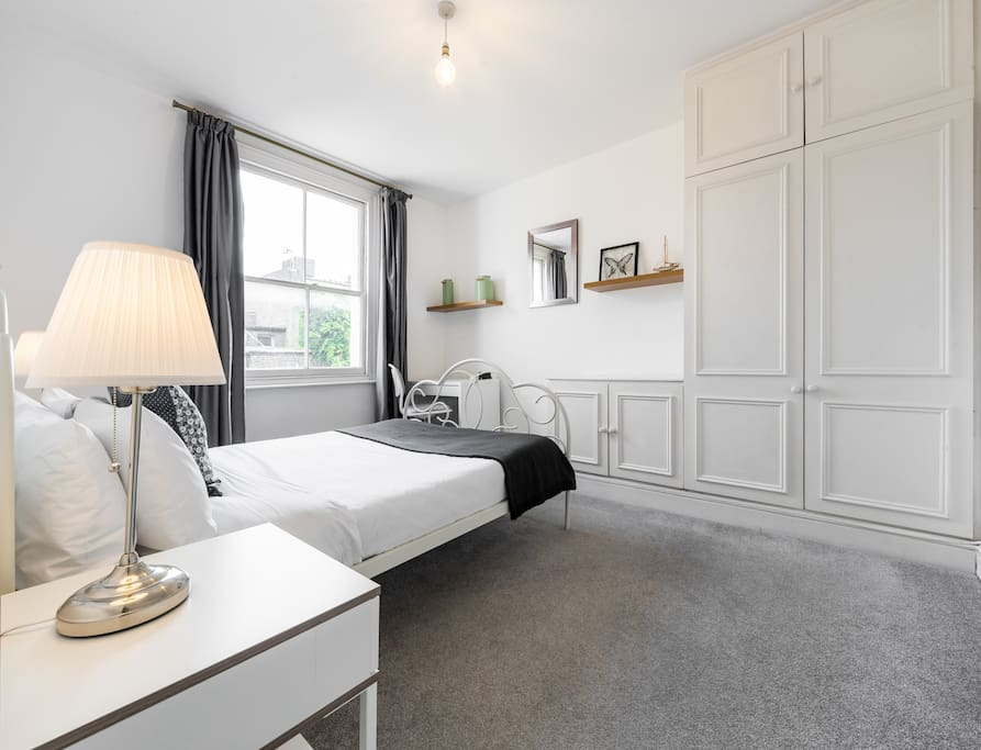 Bright and spacious bedroom with lots of wardrobe space.