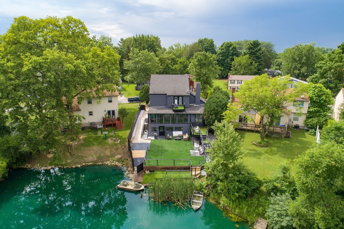 Spacious club house on pond with boats, private terrace, game rooms, and movie theatre.