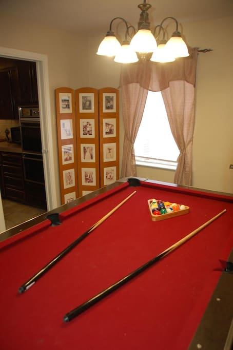 Test your skills on the table game of all table games. Play a game of pool.