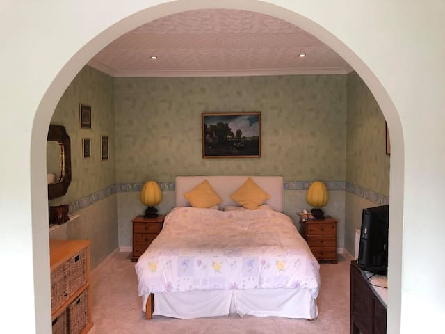 Double bed along with TV