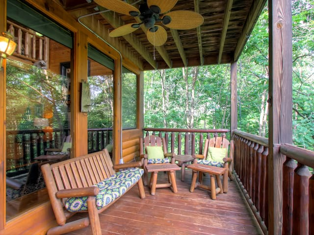 Take in the forest views from the furnished porch.