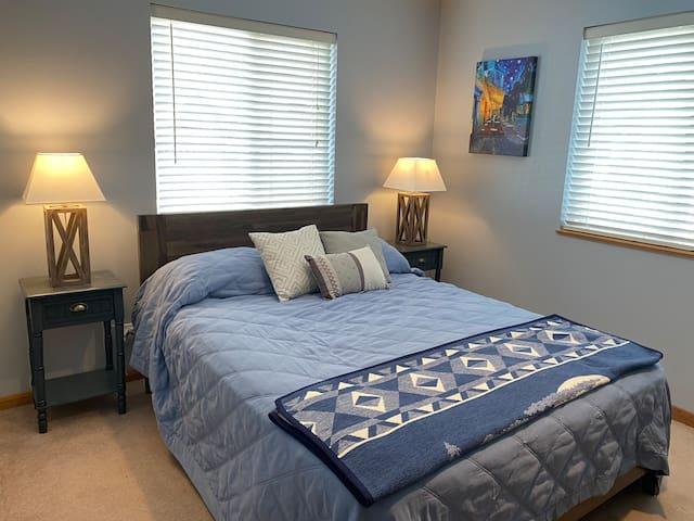#3 Main Floor bedroom with queen bed.