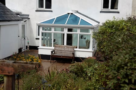 Private apartment with en suite and conservatory.