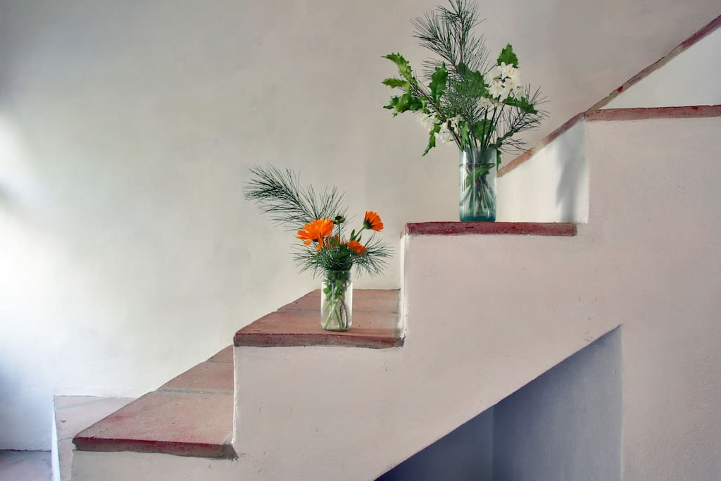 Traditional, Spanish-style open stairway to second floor