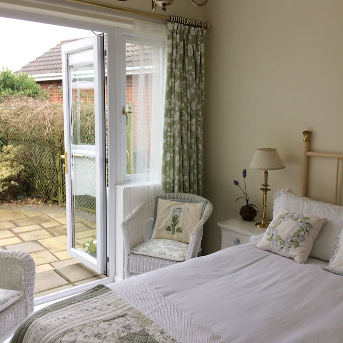 French doors to private outdoor seating area