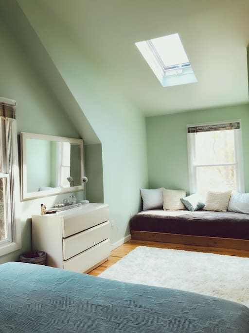 mirror and dresser with comfortable day bed