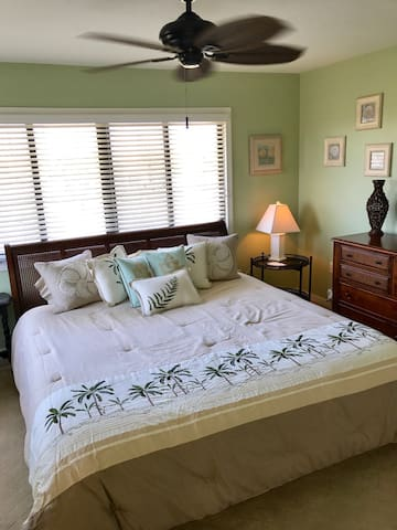 Tommy Bahama themed master bedroom with king bed
