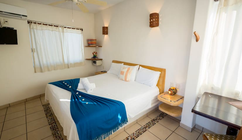 King size bedroom, air conditioning, ceiling fan, cable TV and safe box.