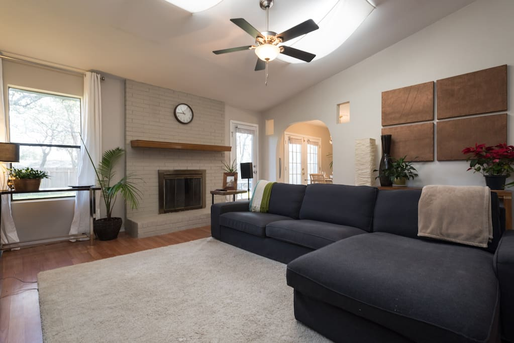 Living room comfortably seats 5, and has extra seating tucked away under a console to extend seating to 7 if necessary. Equipped with a smart tv, bluray player and access to Netflix, Amazon prime video, Hulu, pandora stations for music etc.
