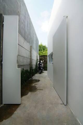Side door to motorbike parking area.