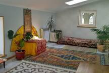 3rd floor mansard sleeping room with 4 windows, carpets and oriental design