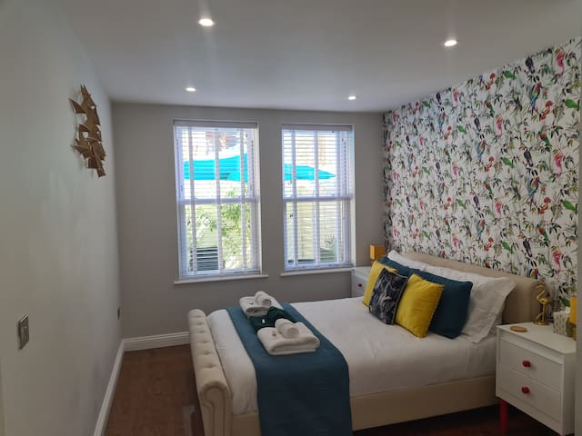 Bedroom area with kingsize bed, overlooking the private courtyard garden.