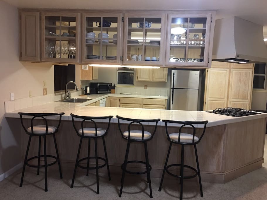The large open kitchen can accommodate multiple chefs while entertaining guests.