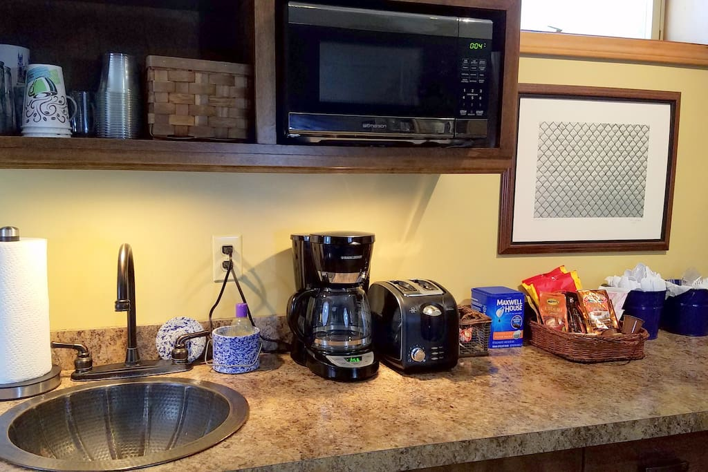 The wet bar has a coffee maker, toaster and microwave. Dishes and utensils are provided.