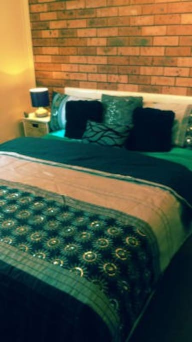 Guestroom, with a queen size bed, Inbuilt mirror wardrobe, With a 32cm flat screen television  with pay TV