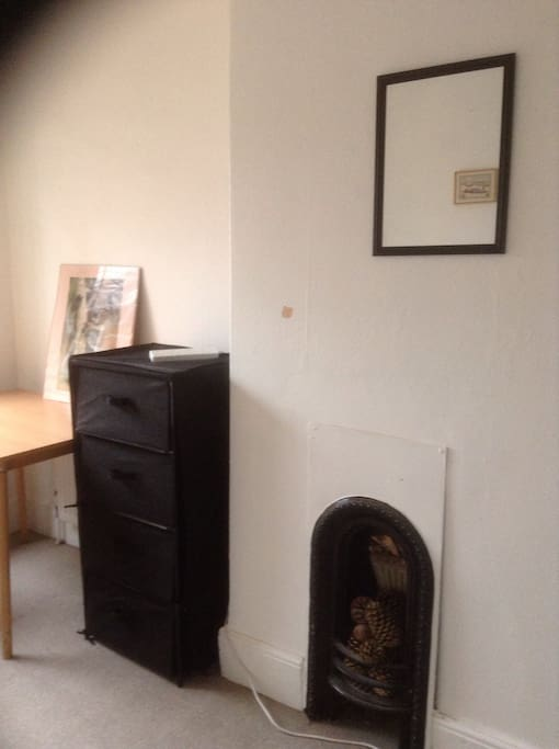 The fireplace is one of the features of this Edwardian house.