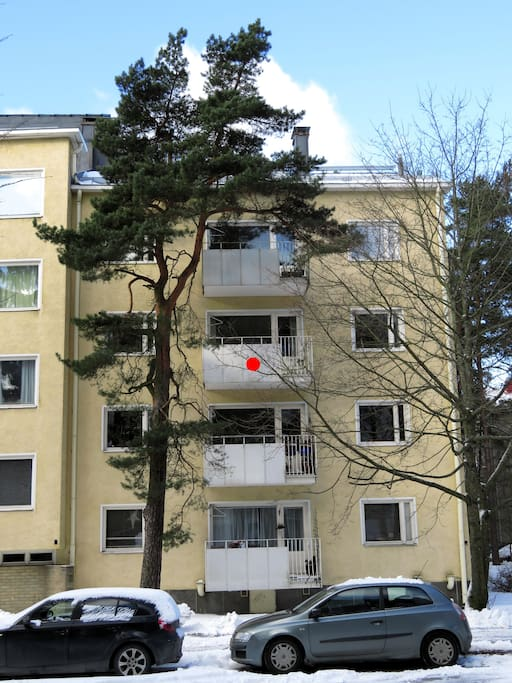View from the street, the apartment is pointed as red pot.