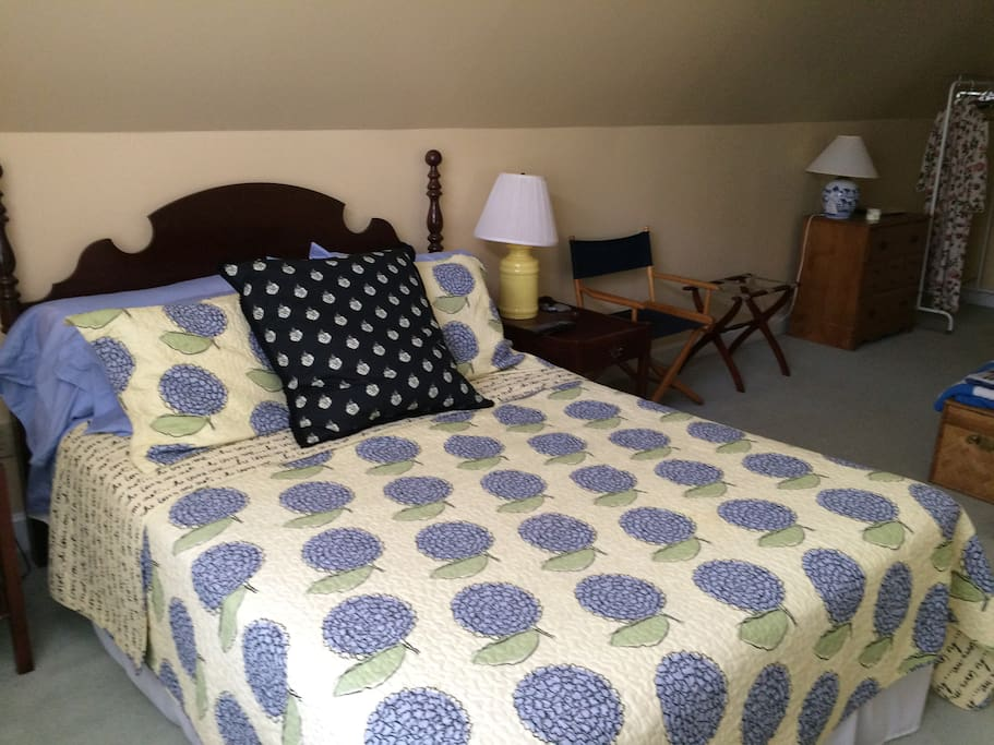 Guest suite includes comfortable queen size bed.