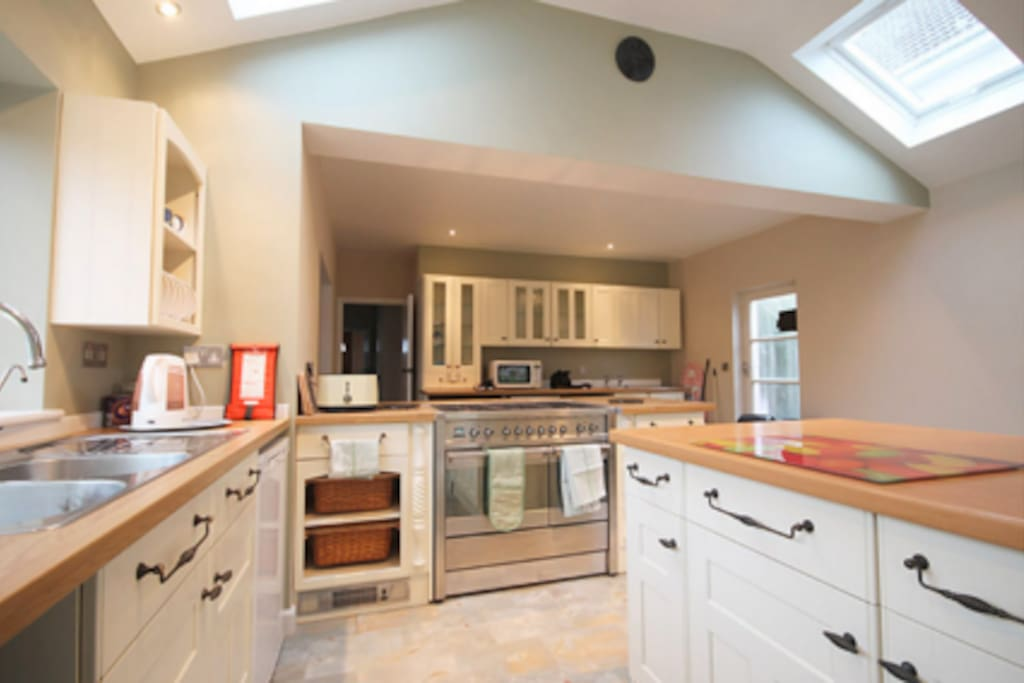 large kitchen diner with patio doors leading to private garden