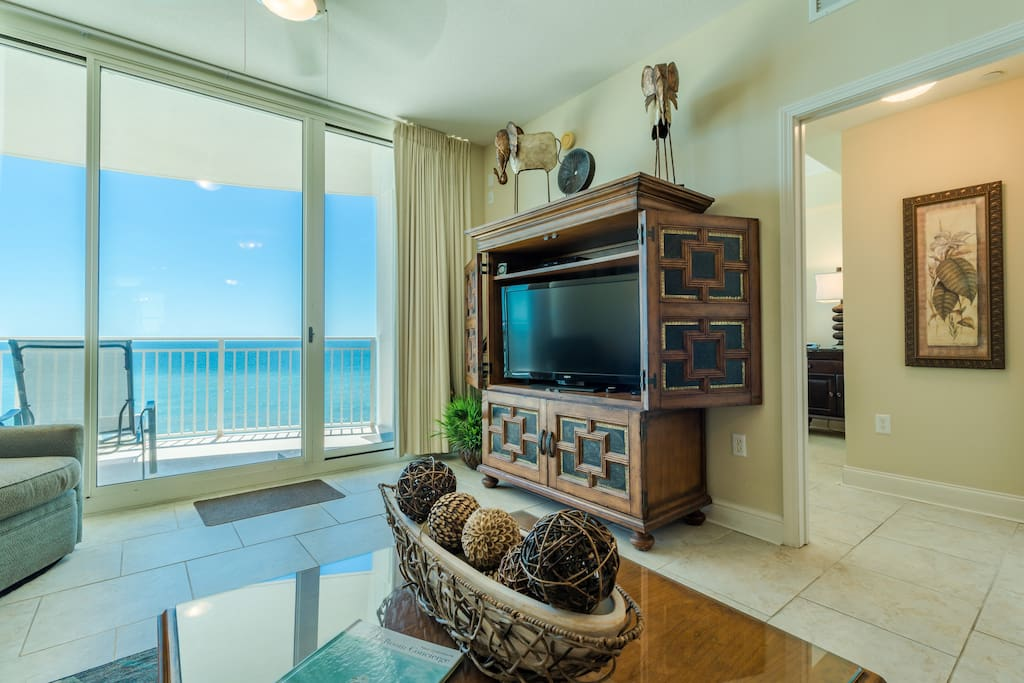 Gorgeous Living Area with Gulf Views, Massive Flat Screen TV, and Super Comfortable Seating for Everyone!