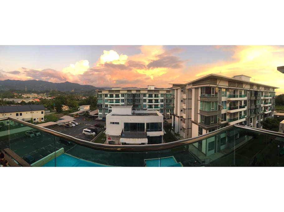 The sunset view from our glass balcony facing the hills, swimming pool & the clubhouse.
