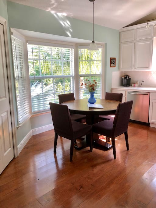 Kitchen with 4 seat table (have 2 additional chairs), pots and pans, oven, stove top, microwave, Keurig coffee maker, dishwasher and refrigerator.