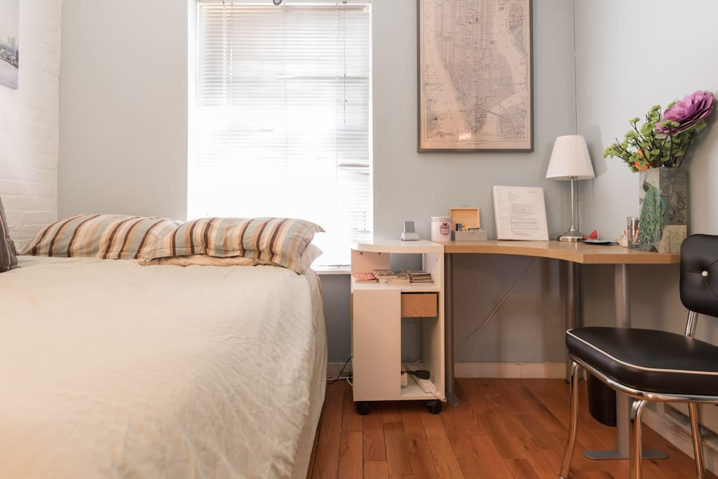 Guest bedroom: Full size bed, exposed brick and window