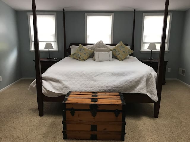 Master bedroom with a king bed on a separate floor