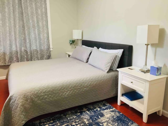 King Size bed with soft sided headboard.