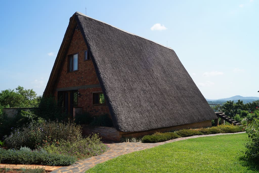 The cottage is an A-framed thatched building