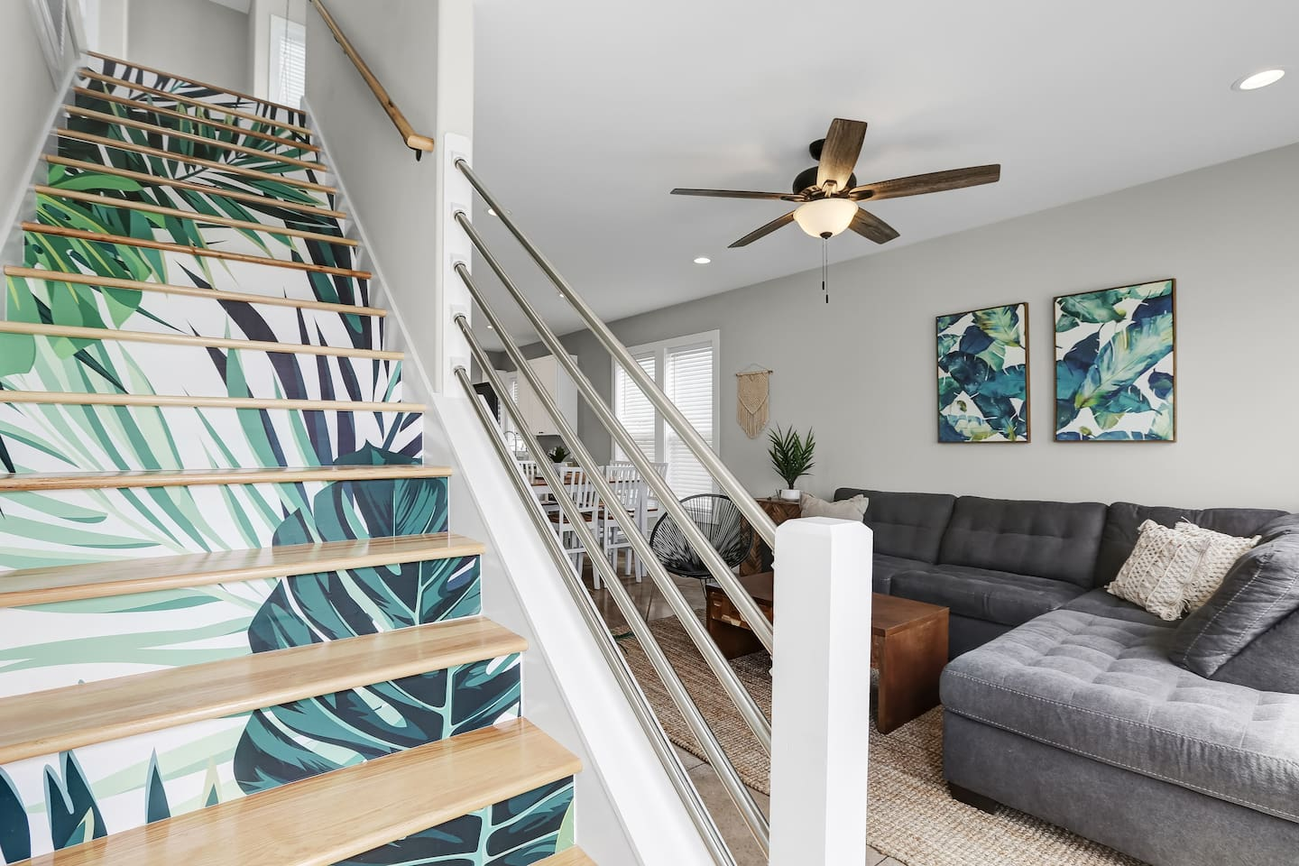 The palm print staircase will steal your attention right when you enter this brand new home!