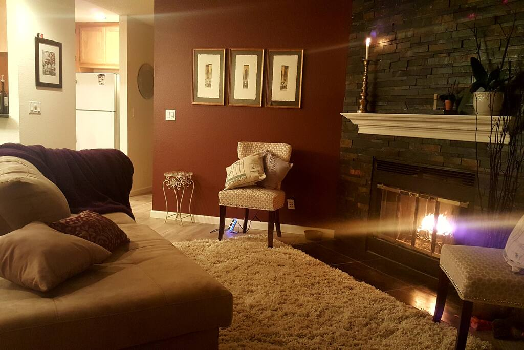 Living room with working stone fireplace