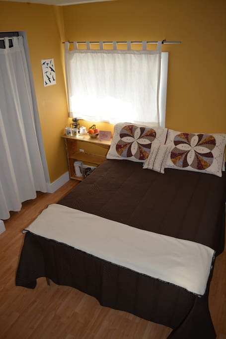 Your room with cozy double bed and walk-in closet.