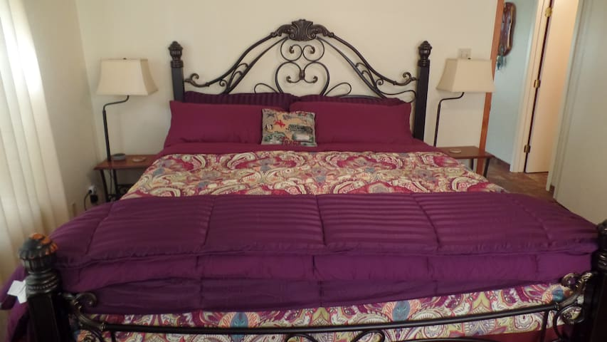 Master bedroom - King size bed, two bed side tables with lamps and Alexa enabled.