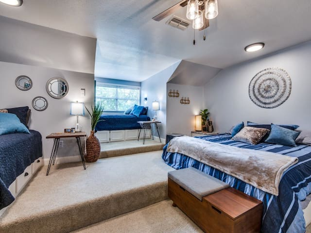 Upstair guest room with a king bed and two twin beds.