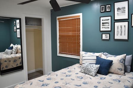 Cozy bedroom includes queen sized bed and closet, useful for extended stays.