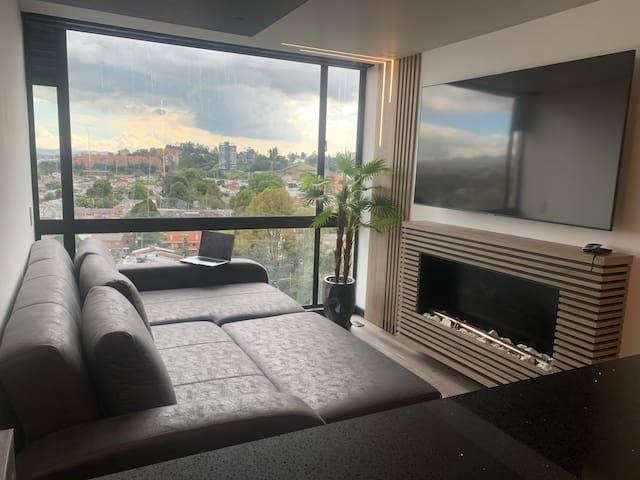 "Sofá cama Premium, tamaño King Size, Smart TV 65 "" chimenea automatica, iluminacion inteligente dimerizada"