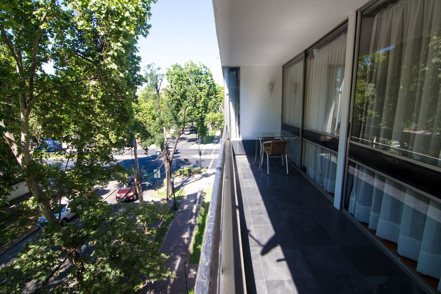 This is my balcony, where you can enjoy readings, meals, conversations, in the company of large trees