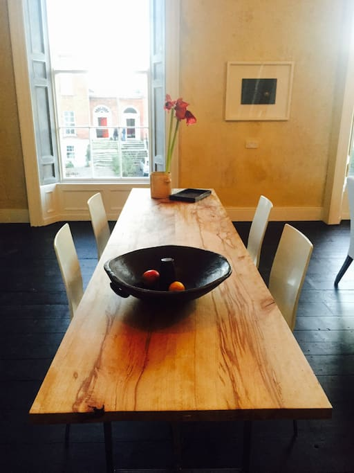 Comfortable dining for ten on custom made spalted beech dining table
