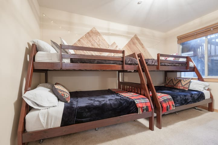Two sets of twin over full bunk beds with plenty of blankets and pillows for all.    The ladders are not permanently attached.  You can store them in the closet if you prefer to not use.