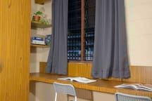 Spacious wardrobe, spacious work table that can accomodate 2 person, and spacious wall shelves for you belonging