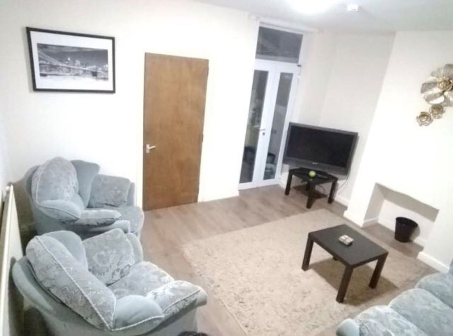 Comfortable large lounge with sofas & TV. Also has extra electrical points so guests can work from here or own room