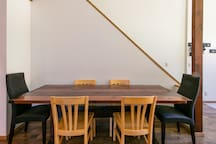 Rustic table, handmade from recycled wood, allows for plenty of seating!  (Extra chairs in closet allow for seating of up to ten people.)