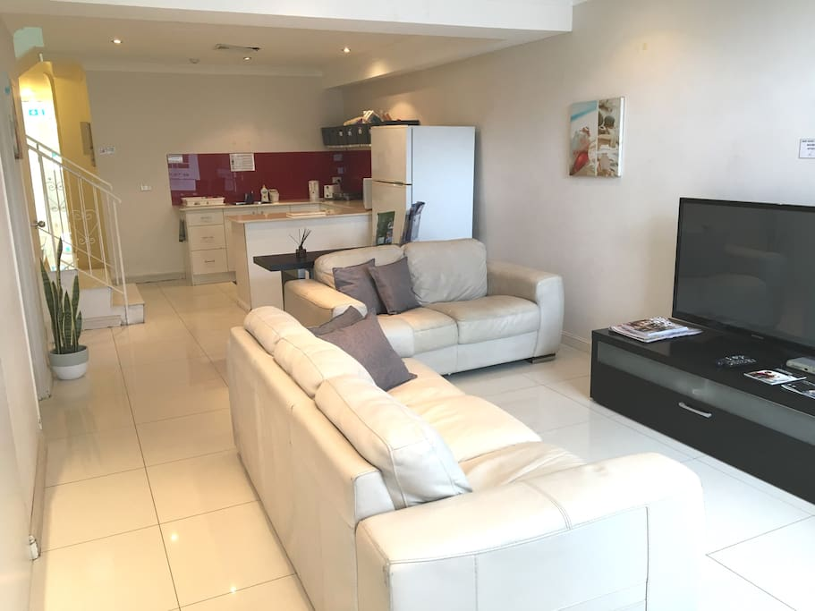 Shared lounge (with cable TV), dining and kitchen areas